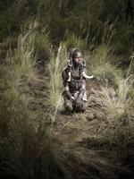 Joey L: Mursi Boy in Tall Grass